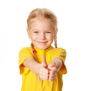 Smiling girl showing thumbs up or OK symbol.