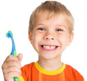smiley boy without one teeth with toothbrush isolated on white background