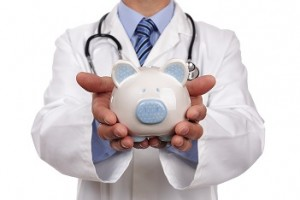 Doctor holding piggy bank concept for healthcare insurance fees and savings for medical expenses