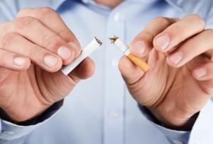 Quit smoking,   human hands breaking up cigarette