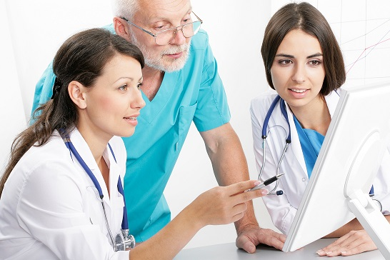 Medical theme: doctors are studying a medical report.