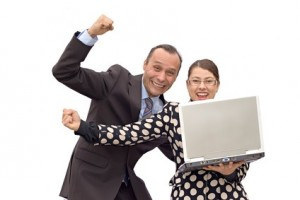 business couple receiving good news and celebrating