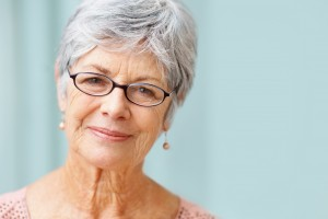 Closeup portrait of a beautiful retired senior woman smiling